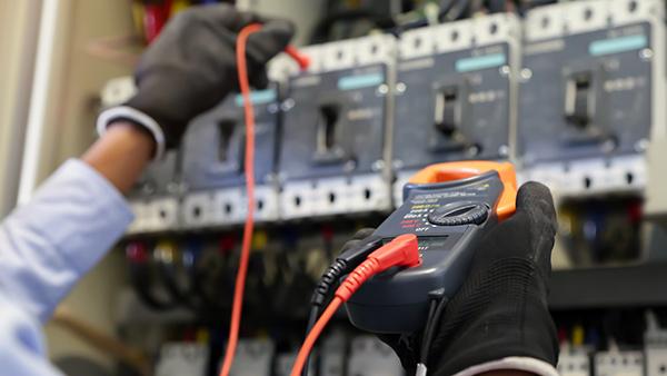 electrical-engineer-using-digital-multi-meter-checking-electric-current-voltage-circuit-breaker-(1)