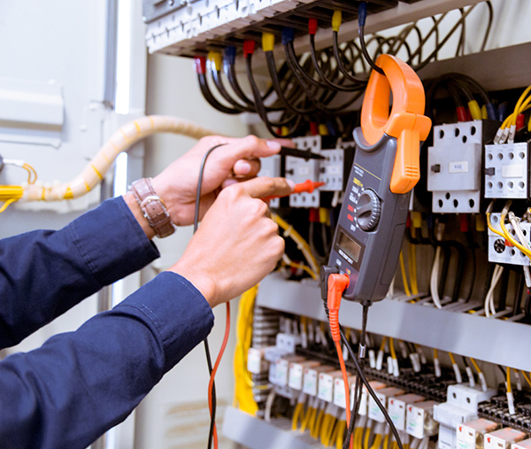 electrician-testing-electric-current-control-panel(1)